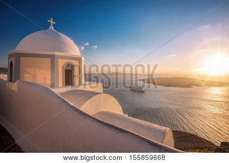 Old Town Of Thira On The Island Santorini, White Church Against Colorful Sunset In Greece