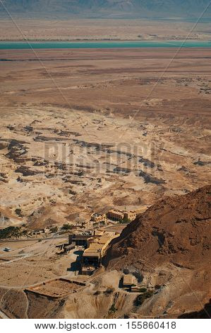 Ruins of fortress Masada. Historical museum.  Judean Desert and Dead sea is on background. Israel.