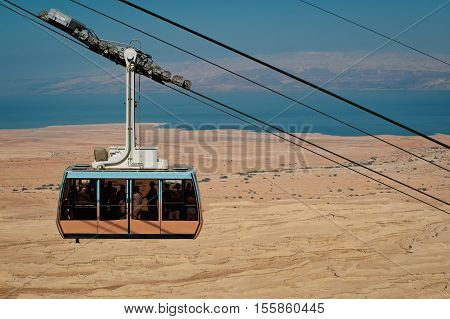 Funicular railway in fortress Masada, Israel. Judean desert and Dead sea on background.
