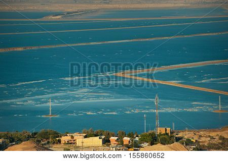 Top view from the Judean Desert on the places salt mining . The Dead sea.
