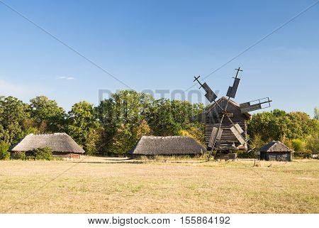 The windmill in the village in Sunny weather in autumn