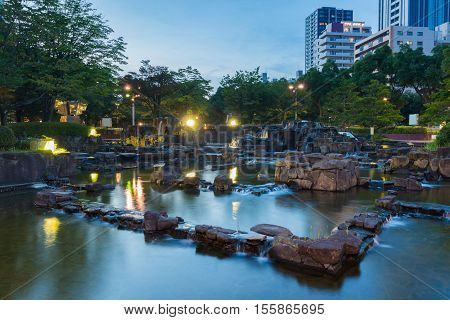 Beautiful Garden With Stone In Small Pond And Waterfall In Downtown.