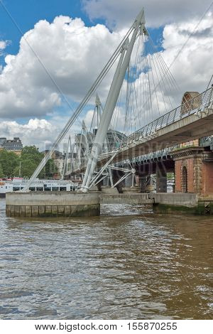 LONDON, ENGLAND - JUNE 15 2016: Hungerford Bridge and Thames River, London, England, United Kingdom
