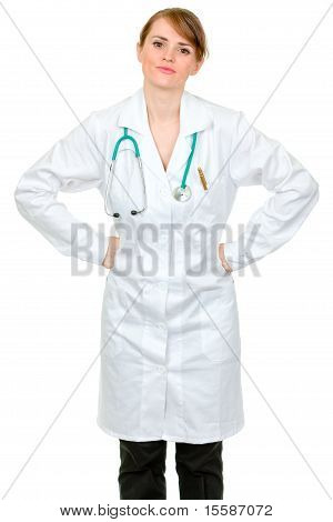Displeased medical doctor woman holding hands on hips isolated on white