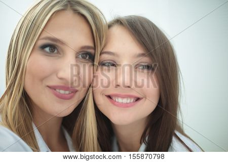 Cheerful team of doctor and intern make selfie