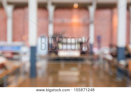 Abstract Blurred Background Interior Of Textiles Factory.