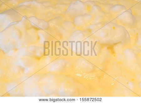 whisked egg whites looking like yellow clouds
