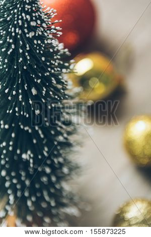 christmas tree and baubles on wood.