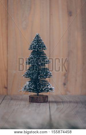 christmas tree,isolated on wooden board,studio shot.