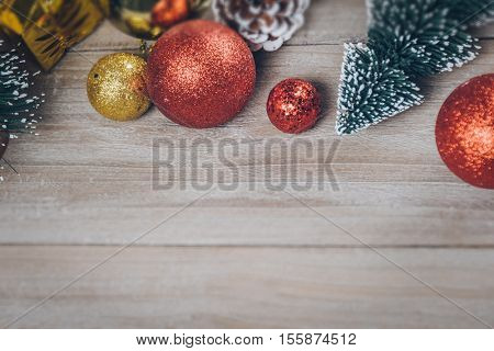 studio shot of christmas ornaments on wooden plank,retro style.
