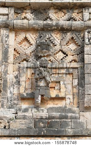 Wall symbol of the god of water Chak in Uxmal Mexico