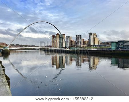 NEWCASTLE - NOVEMBER 9: The Gateshead Millennium Bridge for pedestrian crossing between Newcastle and Gateshead over The River Tyne on November 9, 2016 in Newcastle, UK.