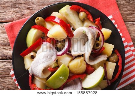 Herring Salad With Potato, Green Apple, Red Onion, Bell Peppers And Olives Close-up. Horizontal Top