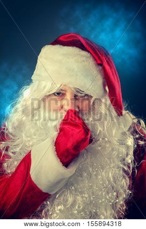 Santa Claus Presses A Finger To His Lips.