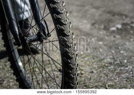 Bicycle Wheel Close Up On The Background Of Road