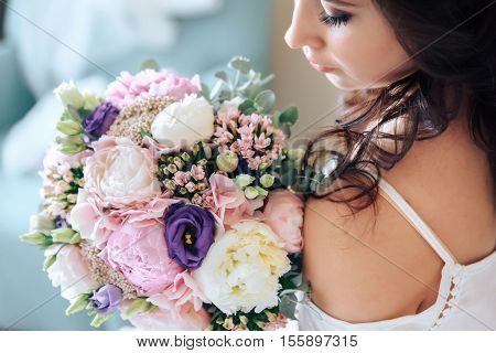 bride holding a bouquet of flowers in a rustic style, wedding bouquet.