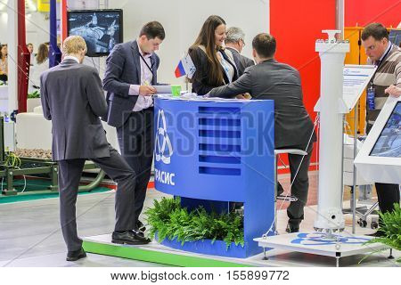 St. Petersburg, Russia - 4 October, Business people interested in the company's prospectus, 2016. Petersburg Gas Forum which takes place in Expoforum.