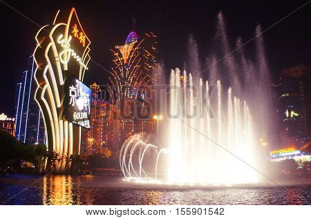 MACAU, MACAU S.A.R. - NOVEMBER 23: The night facades of Grand Lisboa Macau casino resort and Wynn with colored dancing fontains,  luxury hotels in Macau Peninsula on 23th of November, 2015 in Macau.