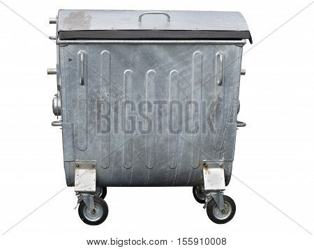 Big dirty metallic trash container isolated on white background