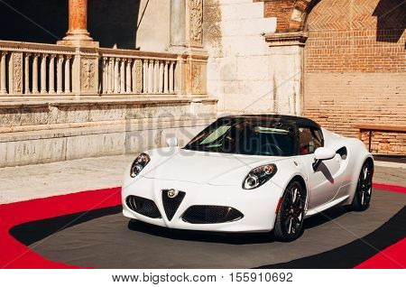 Verona Italy - September 22 2016: White Alfa Romeo 4C car on Piazza Dante in Verona in preparation for
