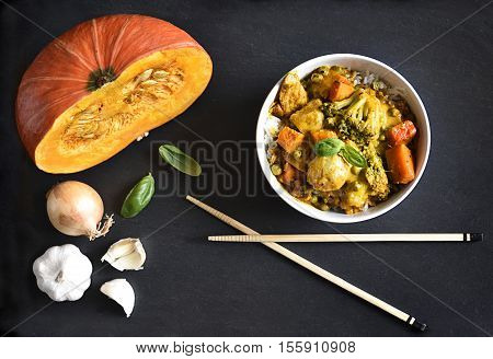 Thai curry or chicken curry. Meal in a white bowl, asian cuisine with chopsticks. high angle view.