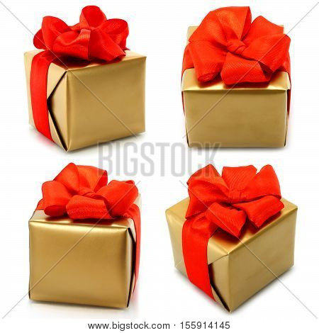 Set of golden gifts with red bow on white background