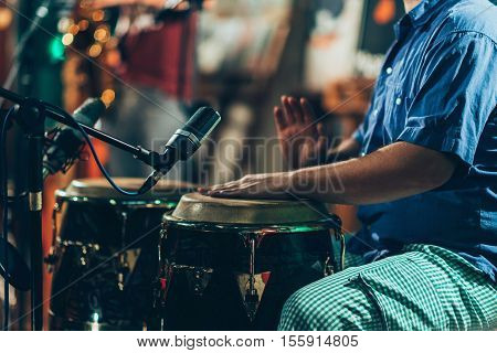 Percussionist playing drums on concert, toned image, horizontal image