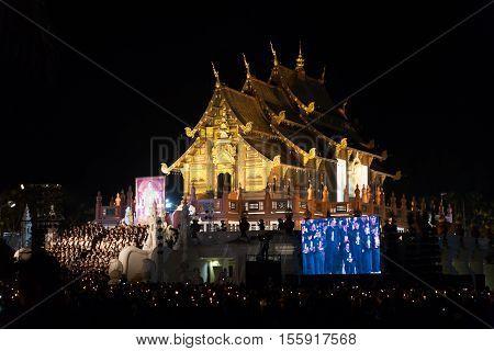CHIANG MAI, THAILAND, NOVEMBER  2: Thai mourners hold candles and pray for the late King Bhumibol Adulyadej at Royal Park Rajapruek Chiang Mai Thailand on November 2 2016.