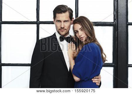 Stunning couple in smart wear james bond style portrait