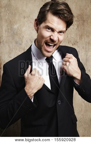 Businessman holding jacket lapels portrait studio shot