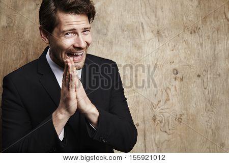 Pleading businessman looking at camera studio shot