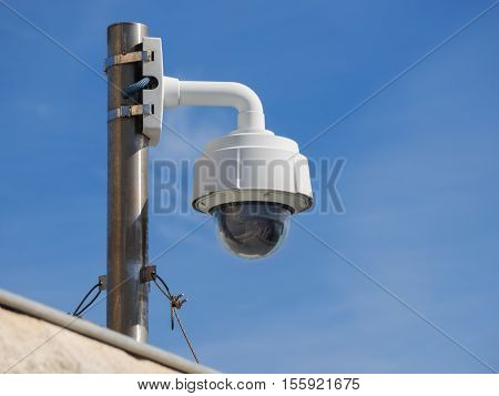 CCTV camera on roof top corner of a commercial building