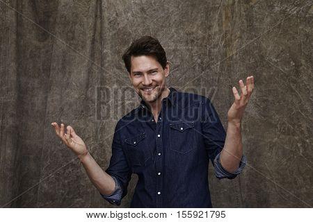 Carefree handsome man in denim shirt portrait