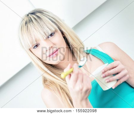 Portrait  Young Woman Eating Yogurt