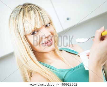 Handsome Woman Eat Yogurt In A Kitchen