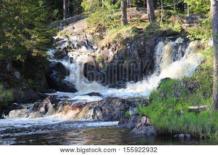 Waterfall in the Republic of Karelia Russia. Northern nature