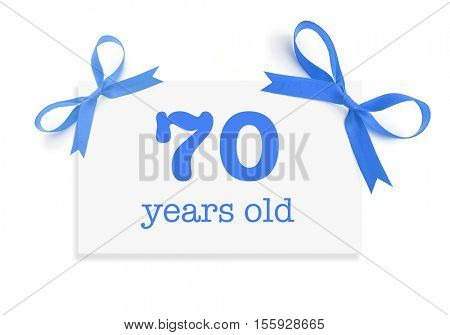 70 years old written on a card