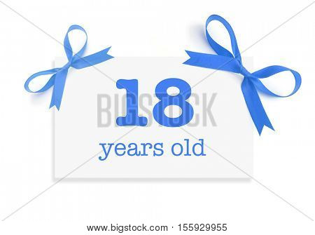 18 years old written on a card
