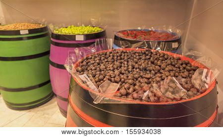 Delicious chocolate candies displayed on wooden barrels ready to be eaten.