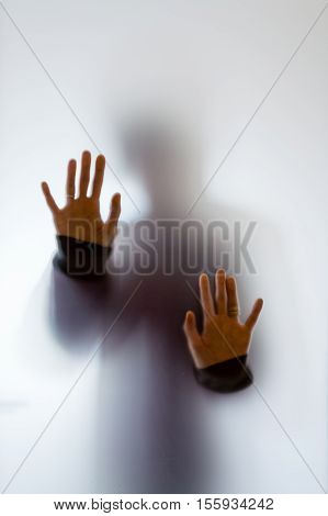 Shadowy Human Figure Behind A Frosted Glass
