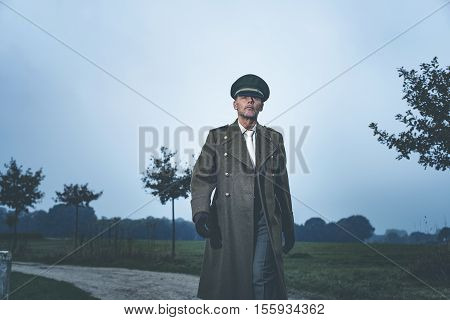 Retro 1940S Military Officer Walking On Rural Road.