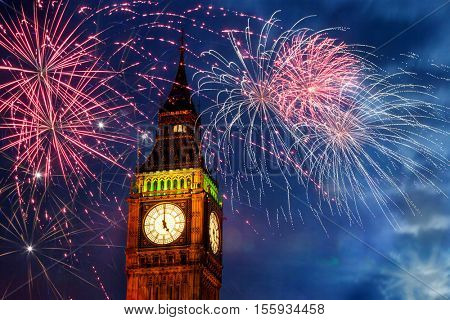 New Year in the city. Explosive fireworks display fills the sky around Big Ben, Westminster, London, UK. Celebration or holiday background