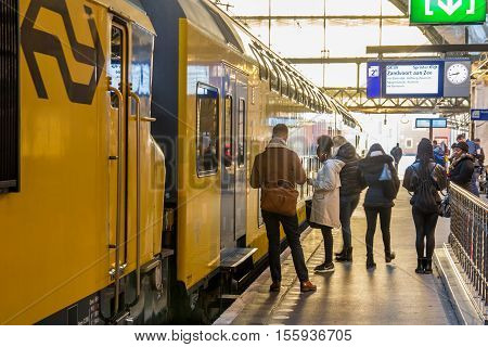 Amsterdam the Netherlands - November 8 2016: passengers waiting to board train at Amsterdam central station