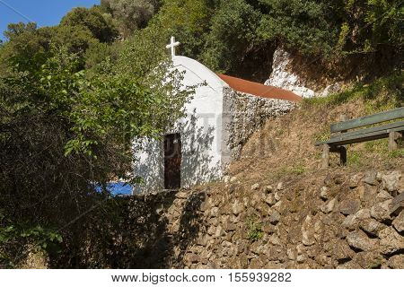 A small Greek Orthodox church in the forests of Crete island