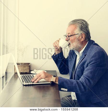 Senior Man Working Coffee Shop Relaxtion Concept