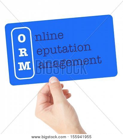 Online Reputation Management explained on a card held by a hand