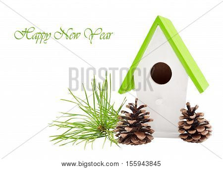 Christmas composition with bird house with pine branches and cones isolated