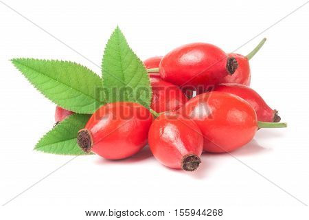 heap of fresh rose hip berry with leaves isolated on white background.