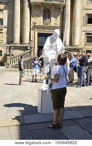 SANTIAGO DE COMPOSTELA, SPAIN - AUGUST 5, 2016: Human statue in front of the cathedral of Santiago de Compostela Galicia Spain