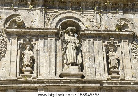 Sculptures of the apostle santiago and two disciples at the Door of Forgiveness in the cathedral of Santiago de Compostela Galicia Spain